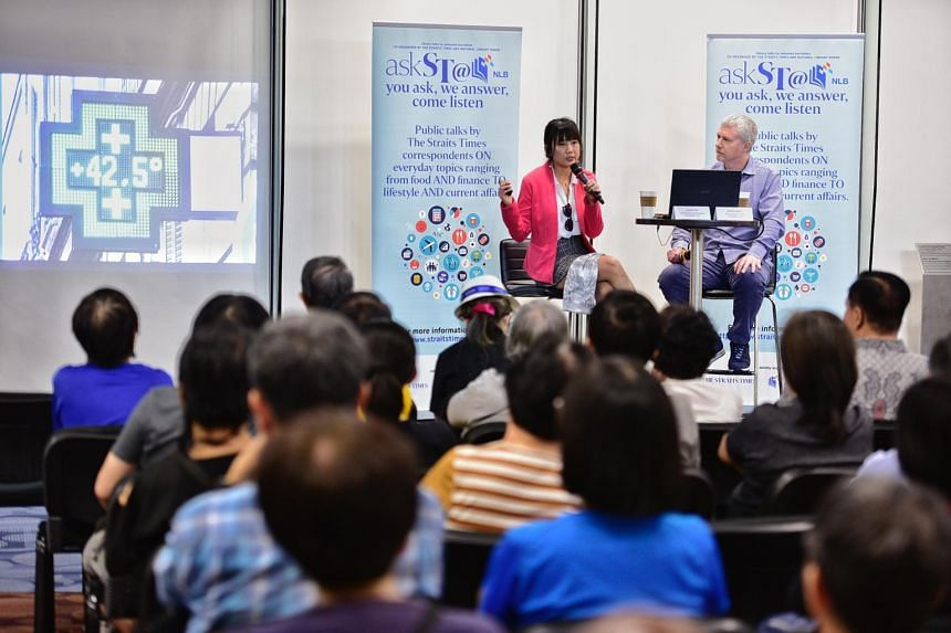 Environment Correspondent Audrey Tan and Climate Change Editor David Fogarty speak about climate change at the National Library on Oct 25, 2019.