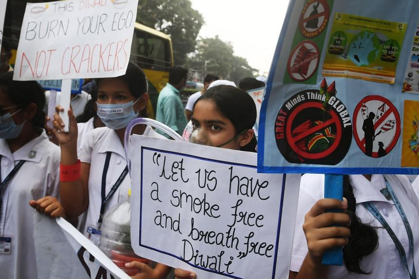 School students take part in a rally to create awareness to stop air and sound pollution by letting off fire crackers in the upcoming Hindu festival of Diwali in Kolkata on Oct 22, 2019.