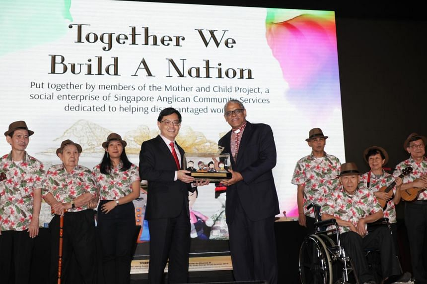 Deputy Prime Minister Heng Swee Keat (centre left) receives a token of appreciation from The Right Reverend Rennis Ponniah at a charity dinner held at the Ritz-Carlton Millenia hotel on Oct 25, 2019.