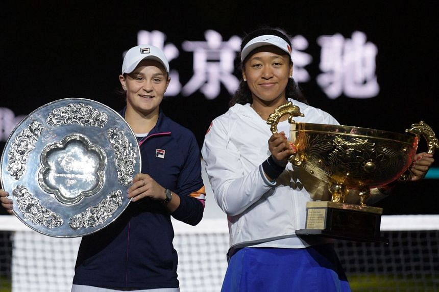 Osaka (right) poses with the winner's trophy after her victory against Barty (left) at the China Open in Beijing.