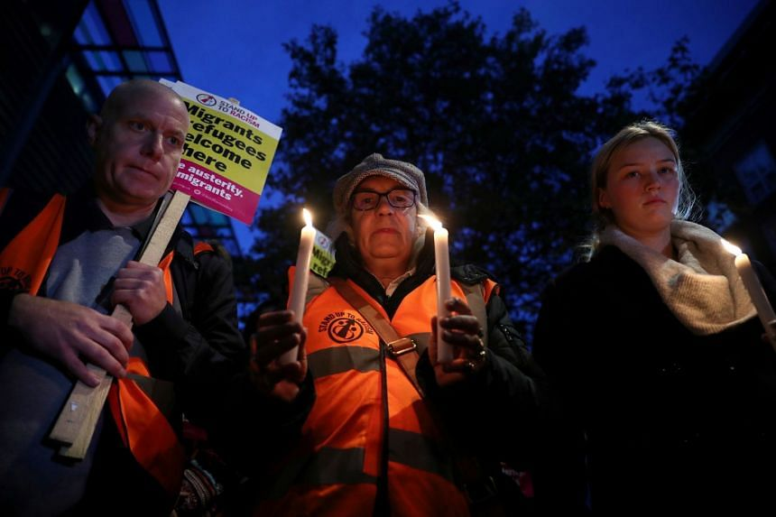 Anti-racism campaigners take part in a vigil in Britain, following the discovery of 39 bodies in a truck container.