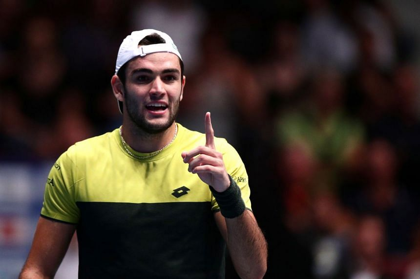 Berrettini reacts during his quarter final match against Russia's Andrey Rublev.