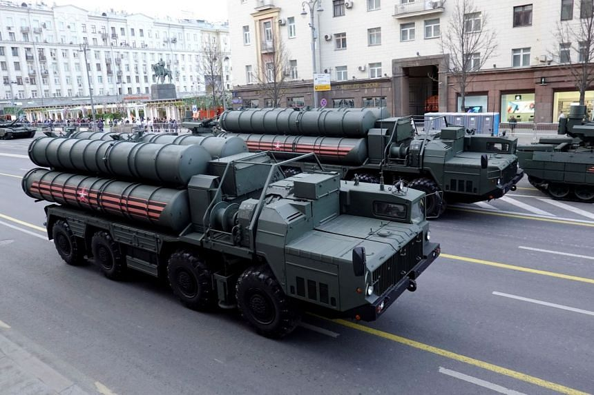 Russian servicemen sit in the cabins of S-400 missile air defence systems in central Moscow, Russia.