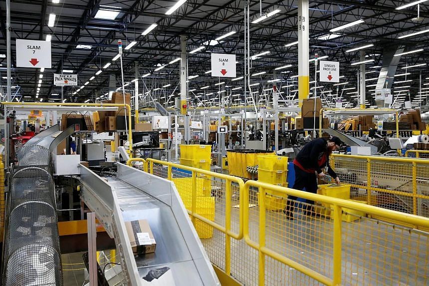 An Amazon fulfilment centre in Kent, Washington. Amazon's fourth-quarter cost for one-day shipping will be nearly double the US$800 million the company spent during the second quarter, chief financial officer Brian Olsavsky said.