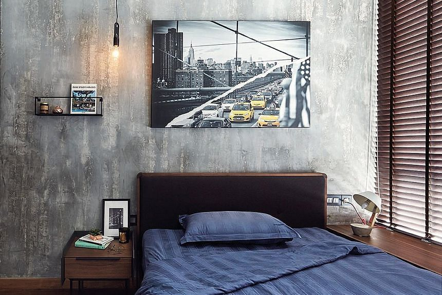 (Right) In the living room, the ceiling has been ripped apart to showcase the pipes and air-conditioning ducts for an industrial-chic feel. (Above) A sleek cabinet with concealed lighting near the apartment's entrance serves as a display for the owne