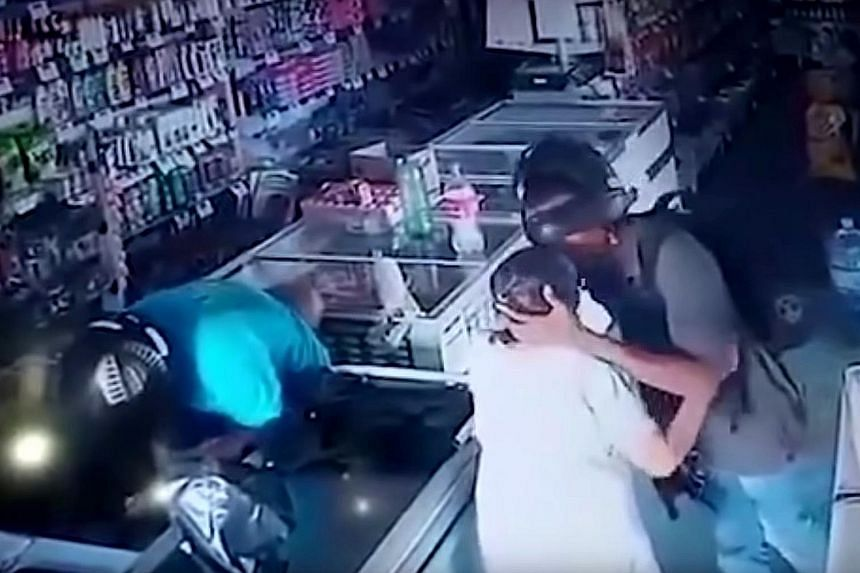 In security video footage posted online, the robber is seen planting a kiss on the elderly woman's forehead. PHOTO: RT/YOUTUBE