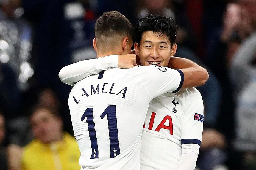 Smiles are back as Tottenham's Son Heung-min celebrates with teammate Erik Lamela after scoring in the 5-0 Champions League thrashing of Red Star Belgrade at the Tottenham Hotspur Stadium in London on Tuesday. PHOTO: REUTERS