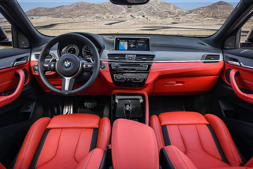 The cockpit (above) of the BMW X2 M35i.
