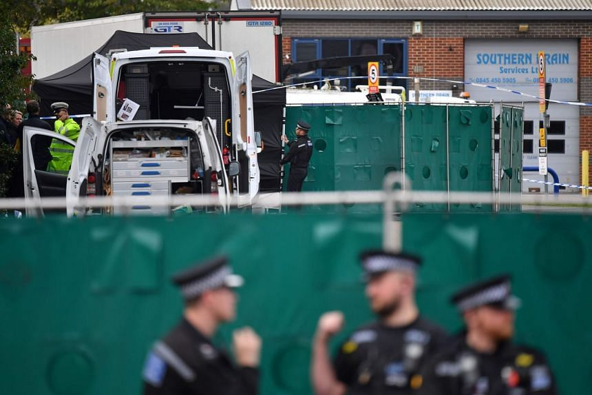 British Police officers work near the lorry in which 39 people were found dead, Oct 23, 2019.