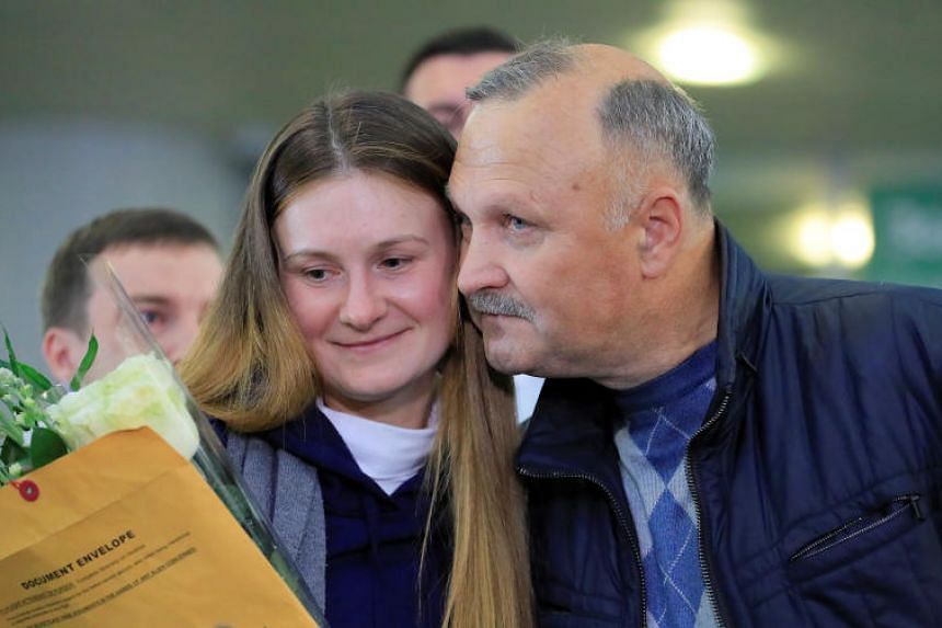Convicted Russian agent Maria Butina, who was released from a Florida prison and then deported by US immigration officials, is greeted by her father at Sheremetyevo International Airport, outside Moscow, on Oct 26, 2019.