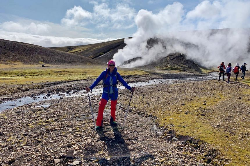 Teammate Erika striking a pose not far from one of the many sulphuric steam vents  encountered on the trail.