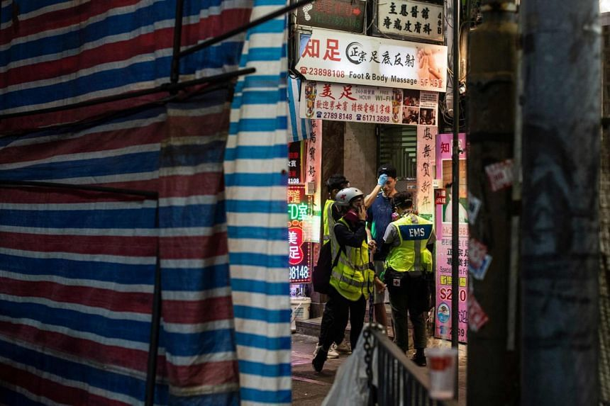 A group of medics help a man to wash his face after Hong Kong police fired tear gas at Mong Kok as people attend a pro-democracy rally in Kowloon district in Hong Kong, on Oct 20, 2019.
