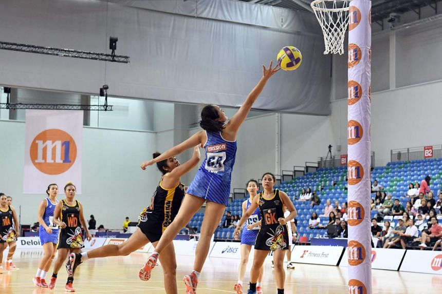 Singapore's Toh Kai Wei and Papua New Guinea's Courtney Abel leap for the ball.