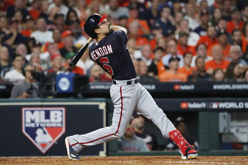 In a photo from Oct 23, 2019, Anthony Rendon of the Washington Nationals swings at a pitch against the Houston Astros during the seventh inning in Game Two of the 2019 World Series at Minute Maid Park in Houston, Texas.