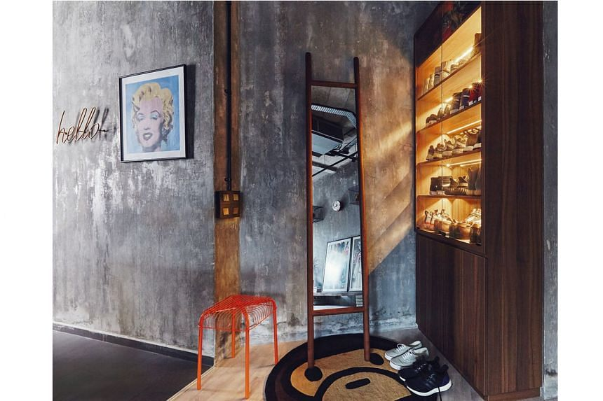 (Above) A sleek cabinet with concealed lighting near the apartment's entrance serves as a display for the owner's shoe collection.