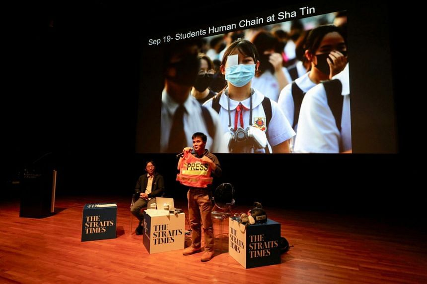 The Straits Times photojournalists Lim Yaohui (left) and Chong Jun Liang at a talk titled The Hong Kong Protest In Pictures, held as part of ST's Through The Lens photo exhibition.