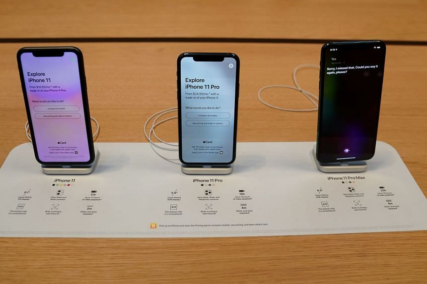 Apple's iPhone 11 models on display at an Apple Store in New York. US President Donald Trump has lamemted the removal of the iPhone home button in a tweet.