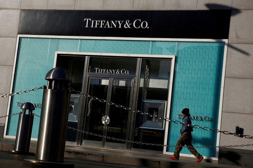A man walks past a boutique of luxury jewellery retailer Tiffany & Co. in Beijing, China.