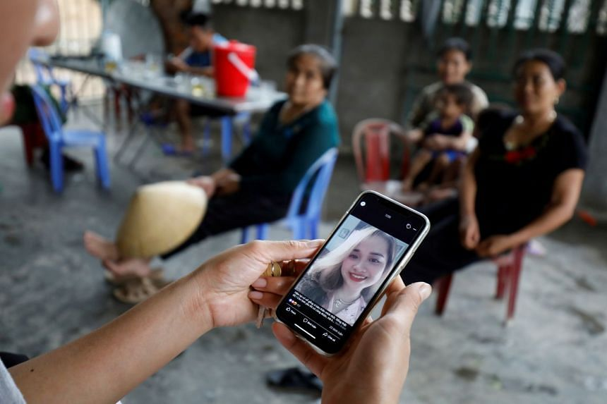 A relative looks at an image of Anna Bui Thi Nhung, a Vietnamese suspected to be among dead victims found in a lorry in Britain.
