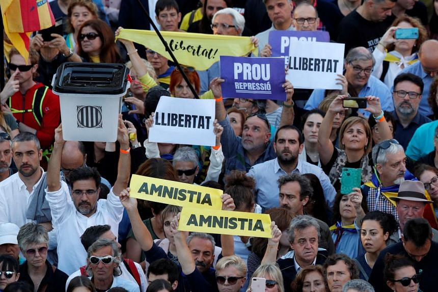 Catalan pro-independence demonstrators attend a protest to call for the release of jailed separatist leaders in Barcelona.