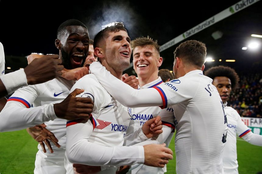 Chelsea's Christian Pulisic celebrates scoring their third goal to complete his hat-trick with team mates.