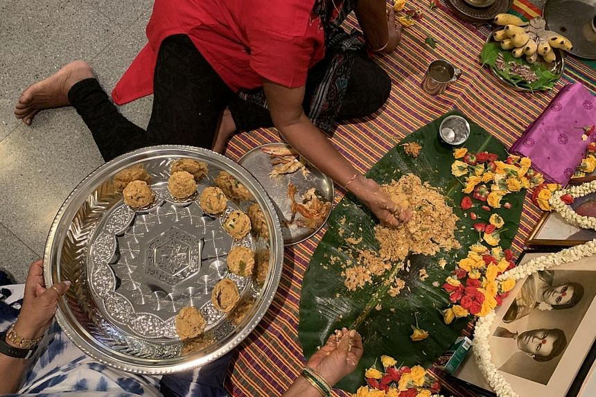 For the ancestral prayer session, about 20 dishes are prepared which, for the writer's family, include everything from dalcha to devil curry (above). After the prayers, the food is mixed and formed into balls (left) and served to everyone who took pa