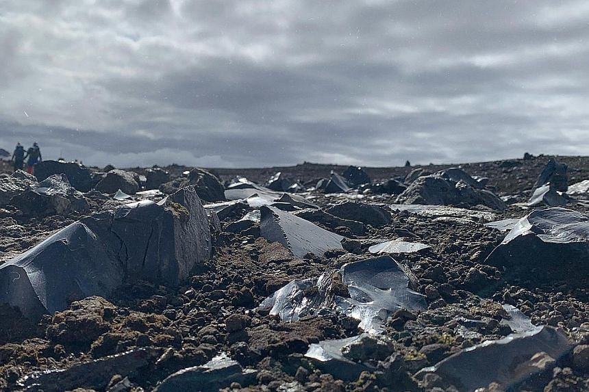 Obsidian rocks jut from the volcanic soil (above); and the team traverses a snow-covered mountain.
