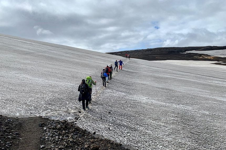 Obsidian rocks jut from the volcanic soil; and the team traverses a snow-covered mountain (above).