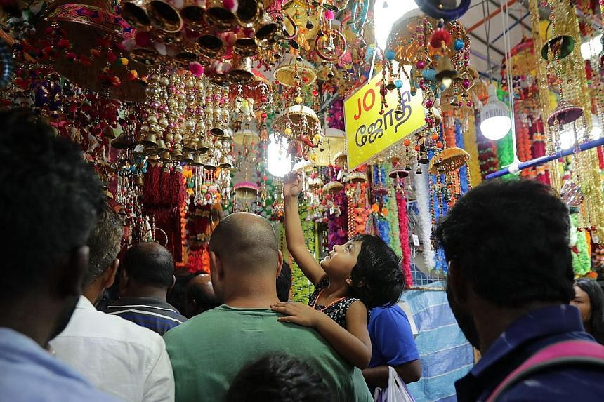 As the streets of Little India glowed with lights, families did their last-minute shopping for colourful decorations, traditional wear and festive treats yesterday evening at the many stalls of the Deepavali Festival Village in Campbell Lane. The ann