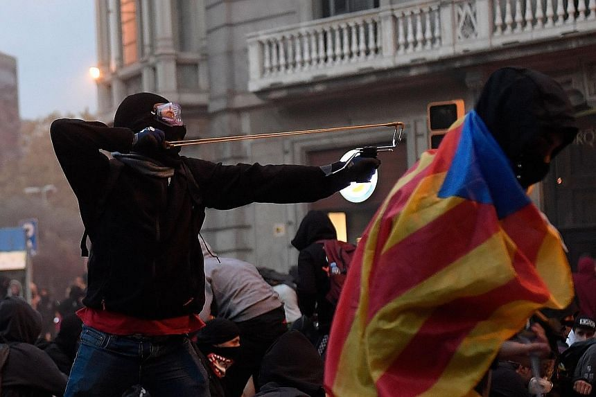 Clashes in Barcelona on Oct 18. Protesters converged for a mass show of dissent over the jailing of nine Catalan separatist leaders.