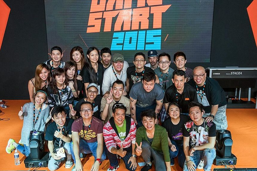 Ms Lee with her team of organisers for GameStart 2015. Ms Lee promoting the Dead Space video game while working for Electronic Arts. Ms Elicia Lee, a psychology graduate, cut her teeth in a few industries, including food and beverage, hospitality and