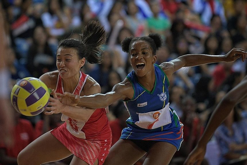 Singapore's Carmen Goh challenged by Namibia's Anna Shipanga for the ball during the M1 Nations Cup final yesterday. Singapore gave up a half-time lead in the seven-goal loss.