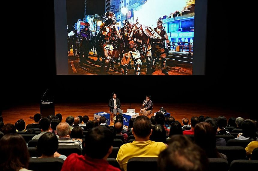 Straits Times photojournalists Lim Yaohui (left) and Chong Jun Liang giving a talk yesterday on their experience covering the political unrest in Hong Kong, at the National Museum of Singapore, as part of the Through The Lens photo exhibition organis