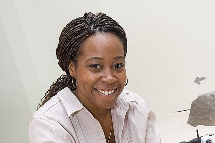Dr Ayanna Howard, a professor and chair of interactive computing at Georgia Tech in the United States, with a robotic toy she and her team designed. The former Nasa researcher stresses the need to consider the human factor in the testing of self-driv
