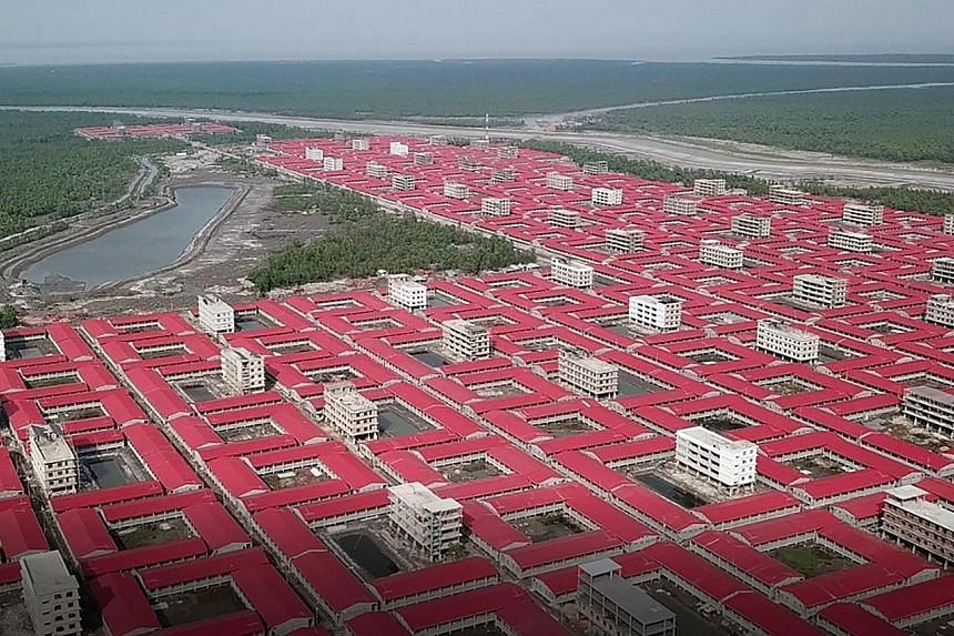 An aerial view of buildings meant to accommodate members of the Rohingya refugee community on the silt islet Bhashan Char in the Bay of Bengal. Bangladesh wants to relocate 100,000 Rohingya to the islet, which is three hours by boat from the mainland