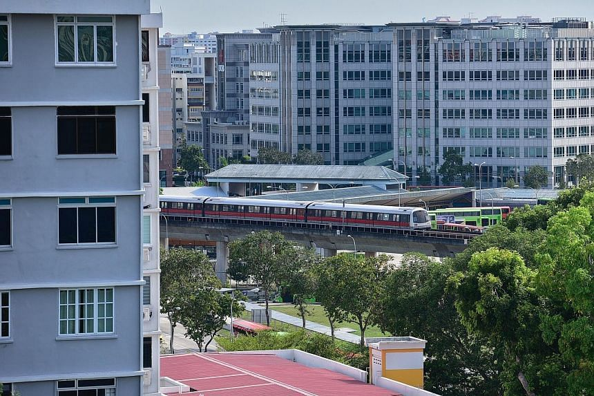 A view from Block 409 Tampines Street 41 overlooking the East-West MRT line. From a sample of 39 Housing Board flats in five locations sold between 2017 and this year, the transacted prices of units that directly faced noisy roads or MRT tracks were