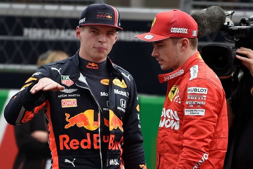Verstappen (left) speaks with Ferrari's Charles Leclerc after finishing in pole position and second position respectively.