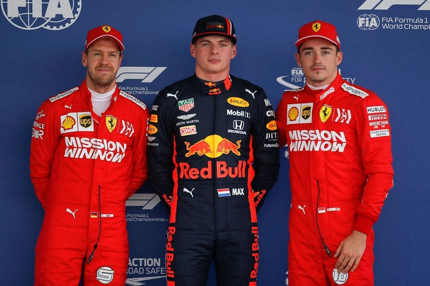 (From left)  Vettel, Verstappen and Leclerc pose for photographers during the qualifying session.