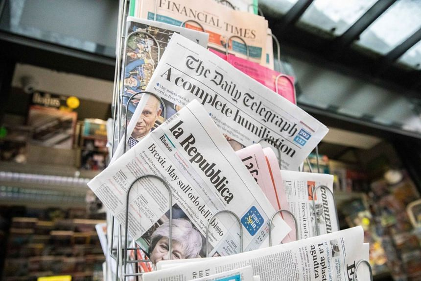 International newspapers including The Daily Telegraph sit on on a newsstand in France.