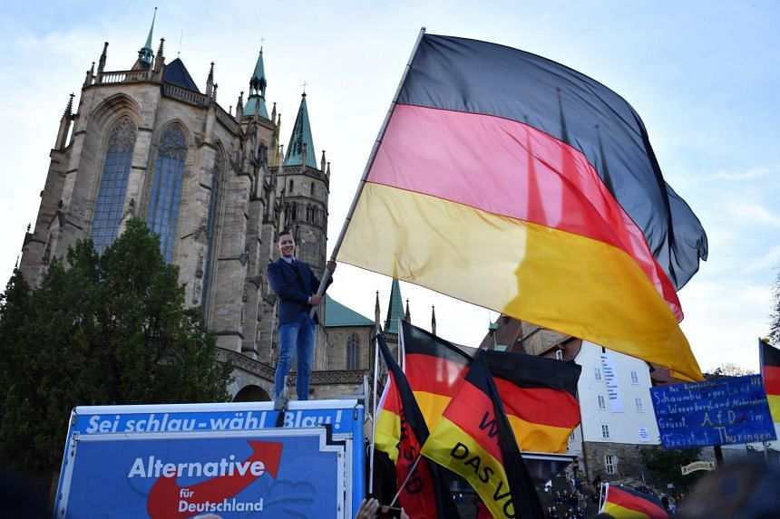 Supporters of Alternative for Germany (AfD) Thuringia wave flags during the final election campaign of the AfD Thuringia on Oct 26, 2019.