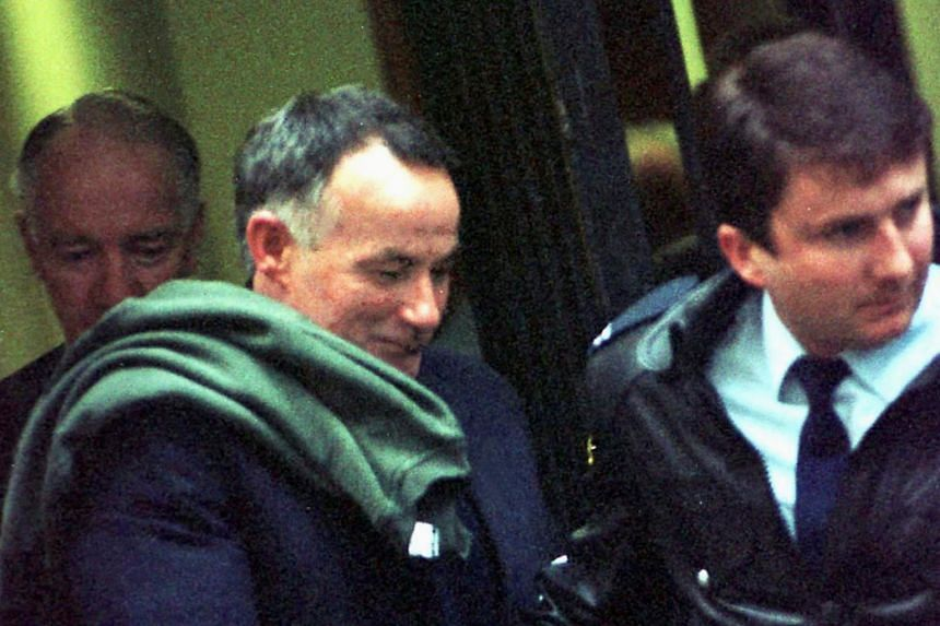Australian serial killer Ivan Milat (centre) is led from court during his trial in Sydney, Australia, on July 8, 1996.
