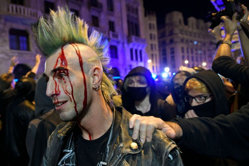 A protester bleeds after allegedly being hit by police during a demonstration in Barcelona.