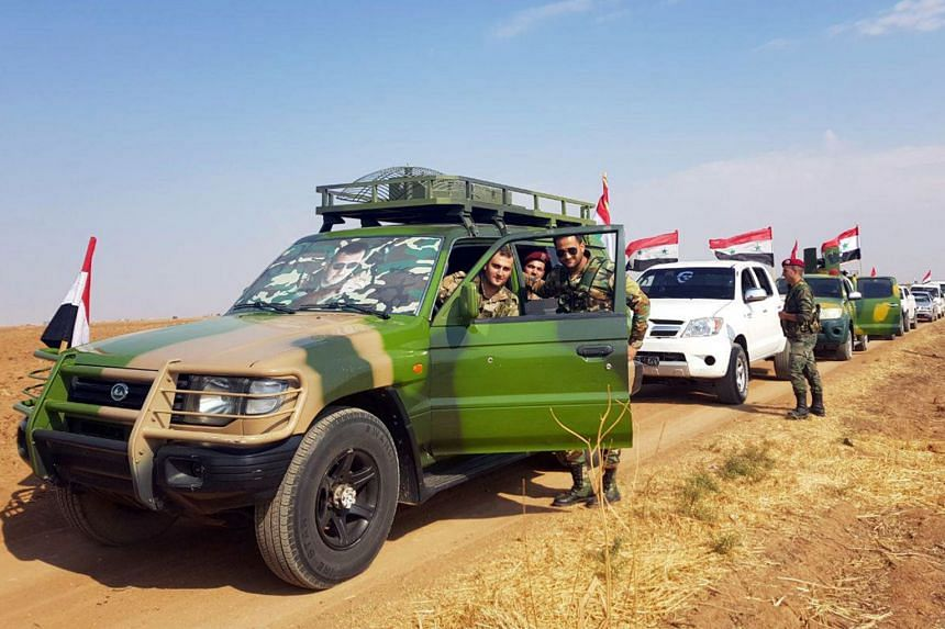 A Sana handout picture shows a convoy of the Syrian army on a road between the northeastern cities of Tal Tamer and Rasal-Ayn in the Hasake province.
