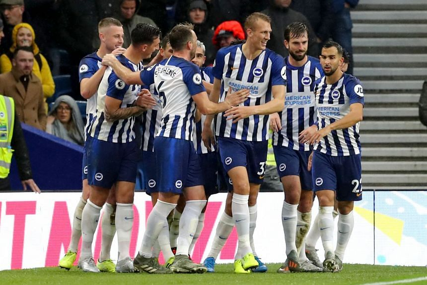 Brighton's Pascal Gross celebrates scoring his side's first goal with team mates.