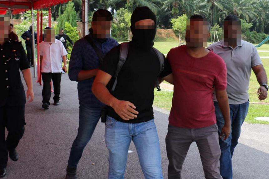In a photo taken on Oct 12, Malaysia's counter-terrorism police arrest men said to be symphatisers of defunct Liberation Tigers of Tamil Eelam.