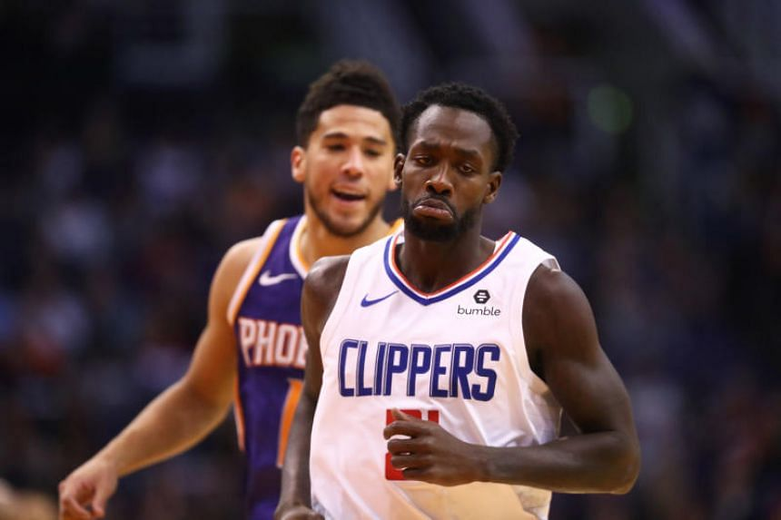 Los Angeles Clippers guard Patrick Beverley (front) reacts as he argues with Phoenix Suns guard Devin Booker in the second half at Talking Stick Resort Arena on Oct 26, 2019.