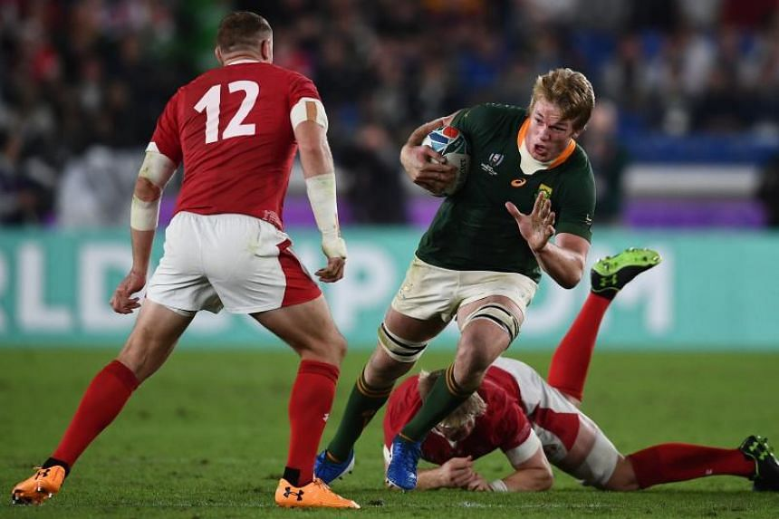 South Africa's Pieter-Steph Du Toit evades a tackle from Wales' Aaron Wainwright during the Japan 2019 Rugby World Cup semi-final match between Wales and South Africa on Oct 27, 2019.