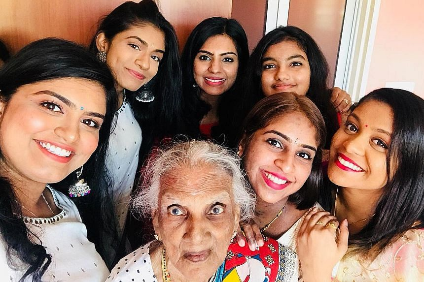 Madam Nadeson Pillai Muthulaxmy with her granddaughters (clockwise from left) Gangaa, Yamunaa, Radha, Tia, Divya and Karthiga at the Deepavali gathering at her flat in Henderson Road yesterday.