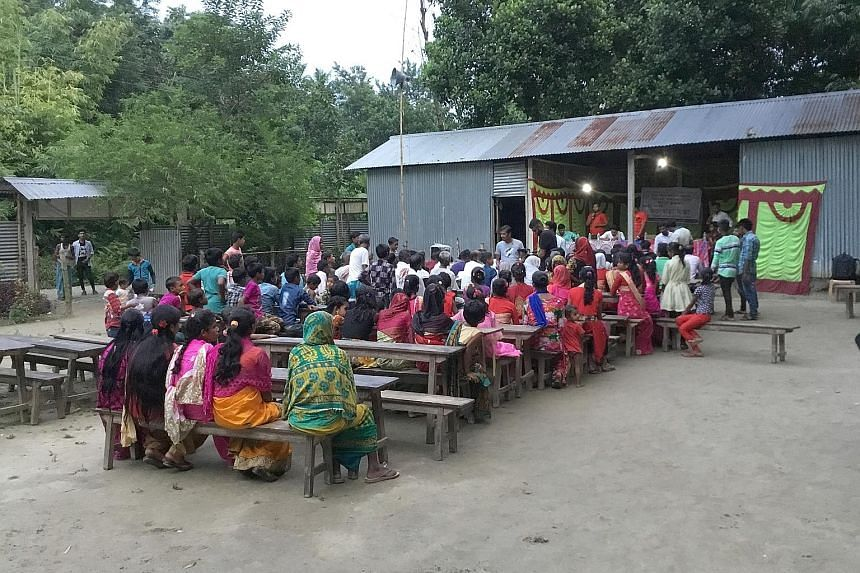 Mr Bassu Ali, 39, who spent more than three years at a detention centre, with his children. They are also not on the NRC and could end up being detained too. Villagers at a public meeting on the National Register of Citizens in Narsingbari village in