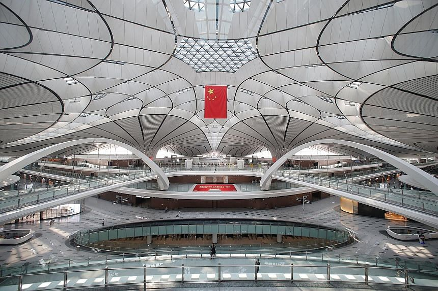 Beijing's new US$63 billion (S$86 billion) Daxing airport began its first scheduled international flights yesterday as it ramped up operations to help relieve pressure on the city's existing Capital airport. Shaped like a phoenix - though to some obs
